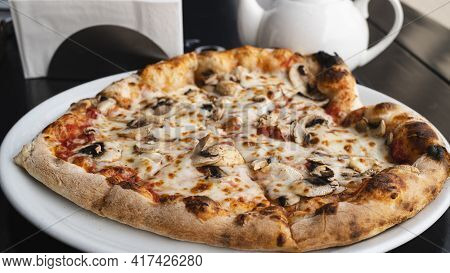 Freshly Baked Pizza With Mushrooms And Cheese. Appetizing Food From Italian Cuisine