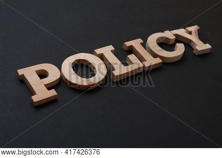 Policy, Text Words Typography Written With Wooden Letter On Black Background, Life And Business Moti