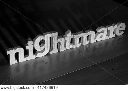 Nightmare, Text Words Typography Written With Wooden Letter On Black Background, Life And Business N