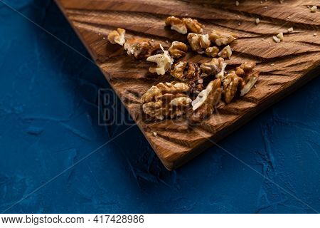 Walnut Kernels On Rustic Board. Concept Of Healthy Food And Vegetarianism