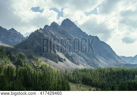 Scenic Alpine Landscape With Great Dragon Shaped Mountain Under Cloudy Sky. Beautiful Mountain Scene