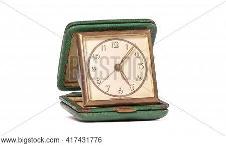Old Green Folding Travel Alarm Clock On White Background