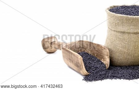 Black Sesame. Black Sesamei N A Sack Of Isolated On A White Background.. Black Sesame In A Burlap Sa