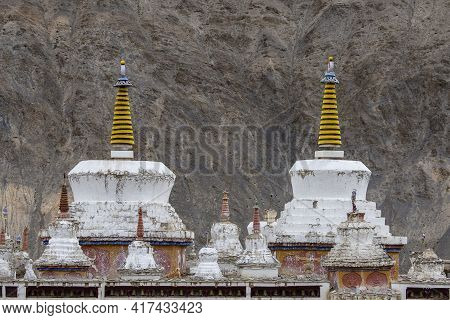 White Buddhist Stupa Or Pagoda In Tibetan Monastery Near Mountain Village Leh In Ladakh Region, Nort