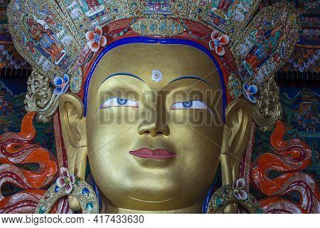 Close Up Of Colorful Statue Of Maitreya Buddha At Tibetan Buddhist Thiksey Monastery Near Mountain V