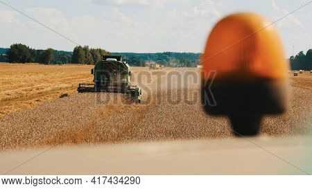 Warsaw, Poland 10.08.2020 - Closeup Of Flashing Light Of A Combine Harvester. Another Harvester Can