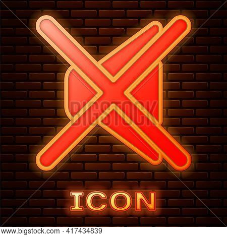 Glowing Neon Speaker Mute Icon Isolated On Brick Wall Background. No Sound Icon. Volume Off Symbol.