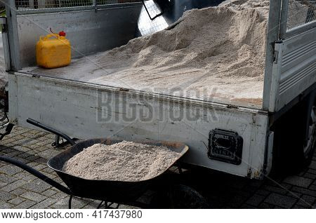 After Pruning A Bunch Of Lawn, Gardeners Apply Silica White Sand. For Better Structure And Airiness