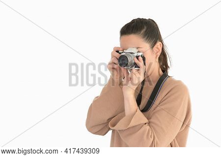 Beautiful Young Girl Taking A Picture With Vintage Camera.isolated On White Background.copy Space
