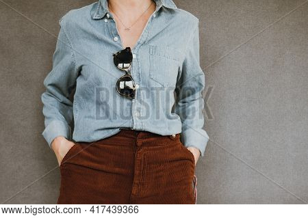 Close Up Of Stylish Young Girl In Casual Look Isolated On Grey Background