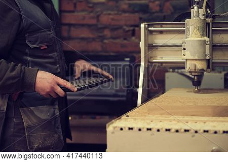 Milling A Wooden Board. Processing Of Wood Panels On Cnc Coordinate Milling Woodworking Machines. Sl