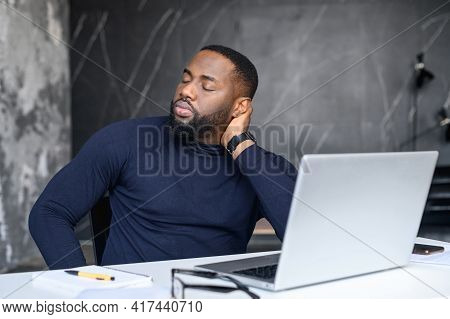 Exhausted African American Worker Felt Asleep At Workplace Sitting At The Laptop, Overworked, Feelin