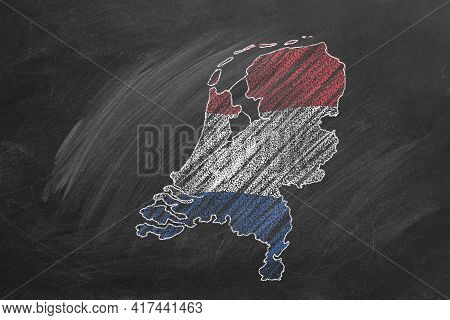 Country Map And Flag Of The Netherlands Drawing With Chalk On Blackboard. Hand Drawn Animation. One