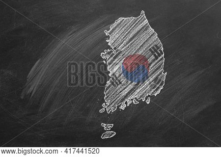 Country Map And Flag Of Korea Drawing With Chalk On A Blackboard. One Of A Large Series Of Maps And