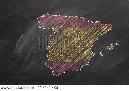 Country Map And Flag Of Spain Drawing With Chalk On A Blackboard. One Of A Large Series Of Maps And
