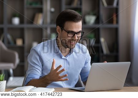 Overjoyed Man Triumph With Good Message On Computer