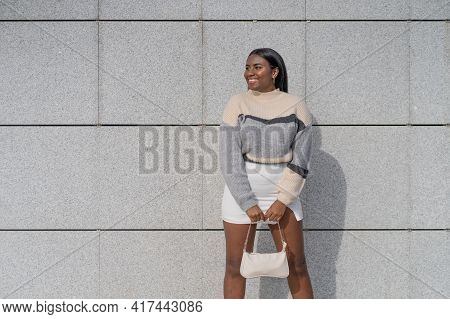 Spectacular And Happy Young Black Woman In Skirt And Sweater