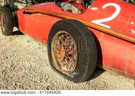 Red Racing Car With The Number 2 On It, And It Has A Flat Tyre.