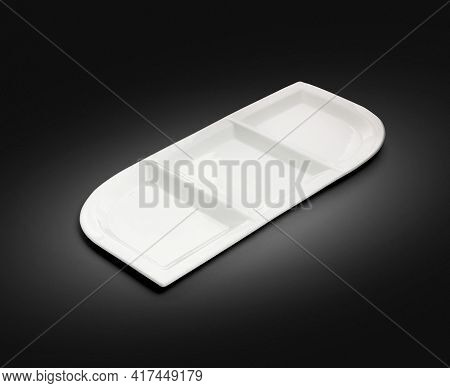 Rectangular Porcelain Plate With Three Compartments On Black Background
