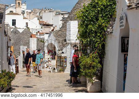 Alberobello, Italy - September 16, 2019:  People Visit Trulli Village In Alberobello, Italy. The Sty