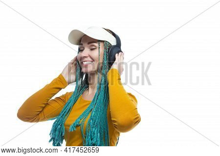 Lifestyle Concepts. Happy Smiling Caucasian Female With African American Dreadlocks Listening Music