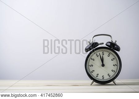 Usd Dollar Sign Print Screen On Alarm Clock On Wooden Table With Copy Space , Money And Time Managem