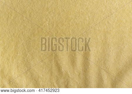 Abstract Yellow Background. Surface Of Fabric, Textile. Terry Towel.
