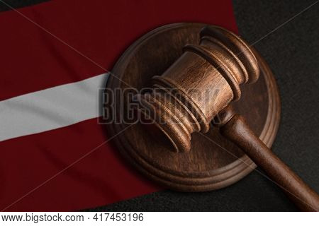 Judge Gavel And Flag Of Latvia. Law And Justice In Latvia. Violation Of Rights And Freedoms.