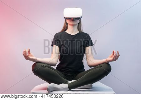 Girl Experiencing Virtual Reality. Woman In Vr Glasses Meditates