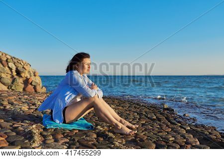 Mature Woman Sitting On The Seashore Enjoying The Seascape, Nature, Sunset