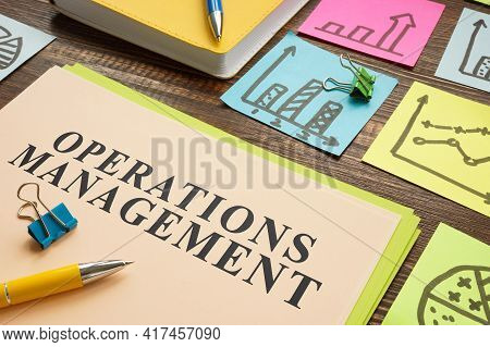 Operations Management Report With Lot Of Memo Sticks.