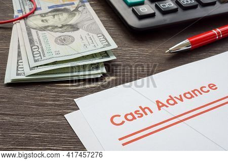 Papers For Cash Advance With Calculator And Money.