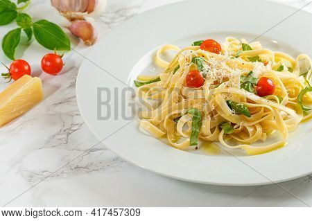 A Bowl Of Pasta Salad On A Plate