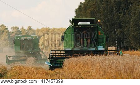 Warsaw, Poland 10.08.2020 - Two Combine Harvesters In An Agricultural Farm Field During The Daytime.