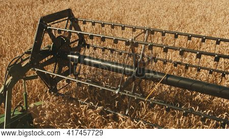 Rotary Straw Walker Of A Combine Harvester Cutting And Threshing Ripe Ears Of Wheat. Cutter Bar Reap