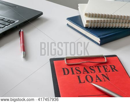 Disaster Loan Form For Signing On The White Desk.