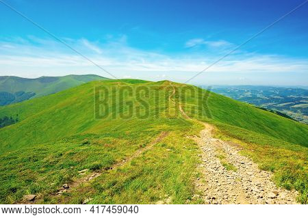 Mountain Landscape On A Bright Spring Day. Path Through Meadow In Grass On The Hill. Wonderful Weath