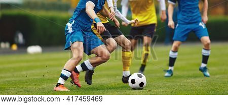 Young Adult Soccer Players Compete At The Pitch. Football League Game. Teenage Sports Players In Jer