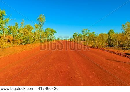 Scenic Outback Road In The Northern Territory, Central Australia In In The Red Center. Red Sand Dirt