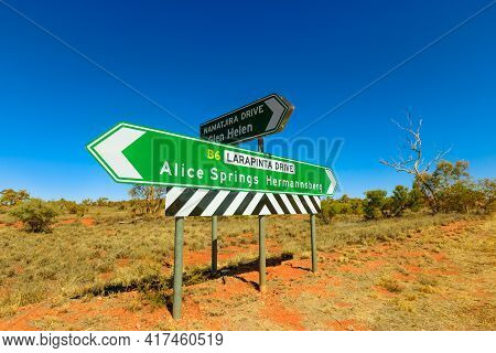 Northern Territory, Australia Outback. Larapinta Drive Signboard Direction Hermannsburg Or Alice Spr