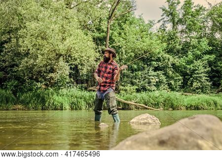 Hobby Is The Work Of Heart. Sport Activity And Hobby. Experienced Fisher In Water. Man Catching Fish