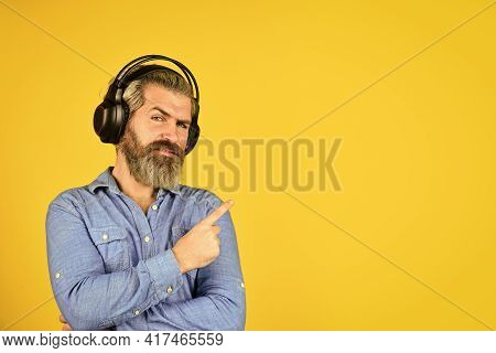 Bearded Man Hipster Pointing Finger, Copy Spce. Listen Audio Book. Music Beat For Energetic Mood. Hi