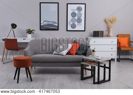 Stylish Grey Living Room Interior With Comfortable Sofa