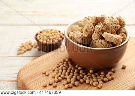 Dehydrated Soy Meat Chunks And Beans On White Wooden Table