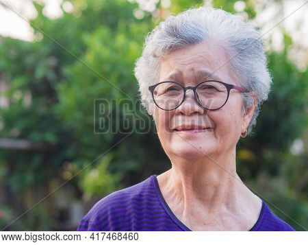 Close-up Of Face Elderly Woman Smiling Happiness, Short White Hair And Looking At The Camera, Standi