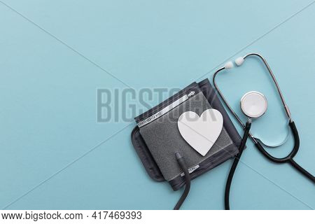 Blood Pressure Test Monitor With A Stethoscope On A Blue Background