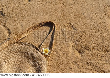 Straw Bag On Sand. Summer Beach Background. Summer Time. Holiday By The Sea.