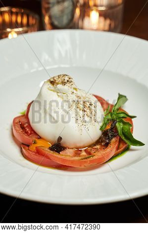 Cheese Bag With Soft Filling And Tomatoes. Burrata Salad