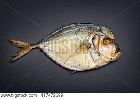 Cooked Sea Fish With Flat Body Isolated On Black Background