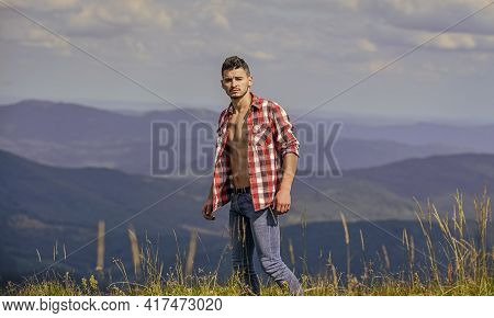 Strong Hiker Muscular Torso. Athlete Muscular Guy Relax Mountains. Hiking Concept. Power Of Nature.